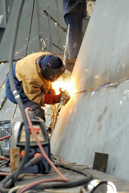 depositphotos_37643915-stock-photo-a-welder-working-at-shipyard